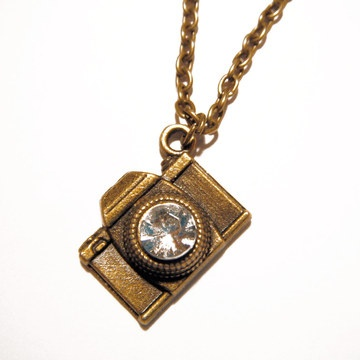 (Ideology) Camera Necklace  @Emily Schwartz, this is on sale for $17 as a Living Social deal right now...