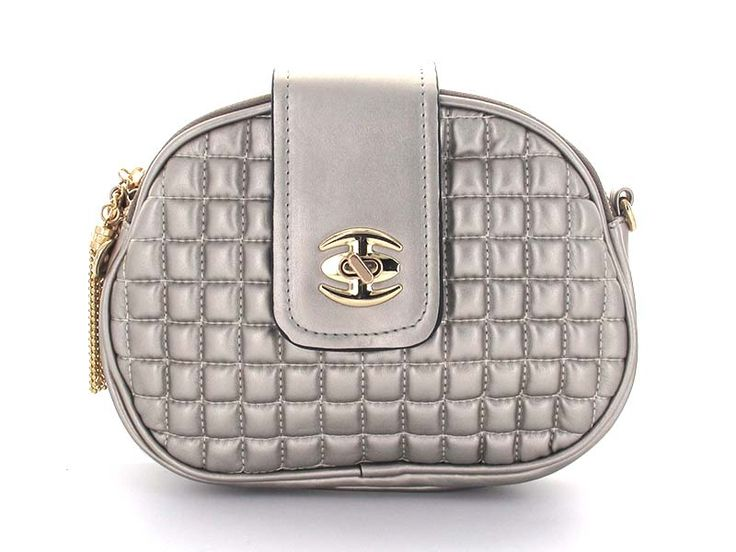 Silver Quilted Double Zipper Crossbody - A multi-functional bag with double zipper enclosures, allowing for greater organization. The chainlink strap can be removed and the bag carried as a clutch. Perfect for the daytime, as the crossbody design allows for effortless hands-free style. Easily turns into an evening bag by simply removing the chainlink strap.   Available in; Bronze and Silver.