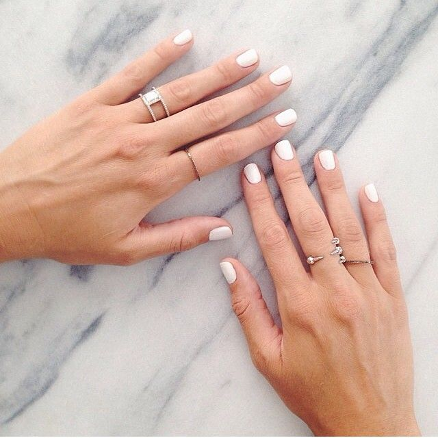 White manicure with silver rings