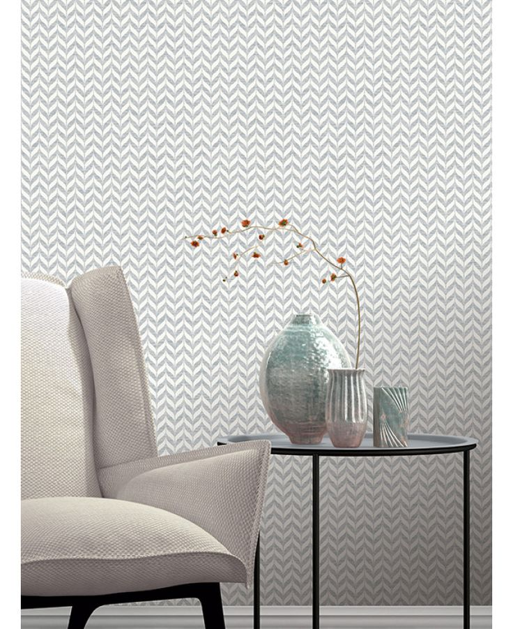 This Incanto Leaf Geometric Wallpaper in grey and white features a geometric leaf pattern with contrasting finishes and glitter and metallic elements. Free UK delivery available