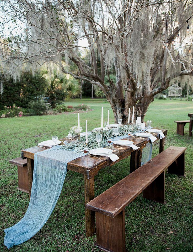 Florida Nursery Wedding with a blue cheese cloth runner