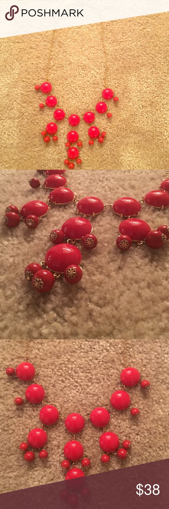 J. Crew red bubble necklace J. Crew red bubble necklace. Great condition! Amazing quality! Has adjustable clamps to adjust how long or short you want the necklace to be. The perfect statement necklace. Getting rid of because I have too many other colors that I wear more often in the necklace. J. Crew Jewelry Necklaces