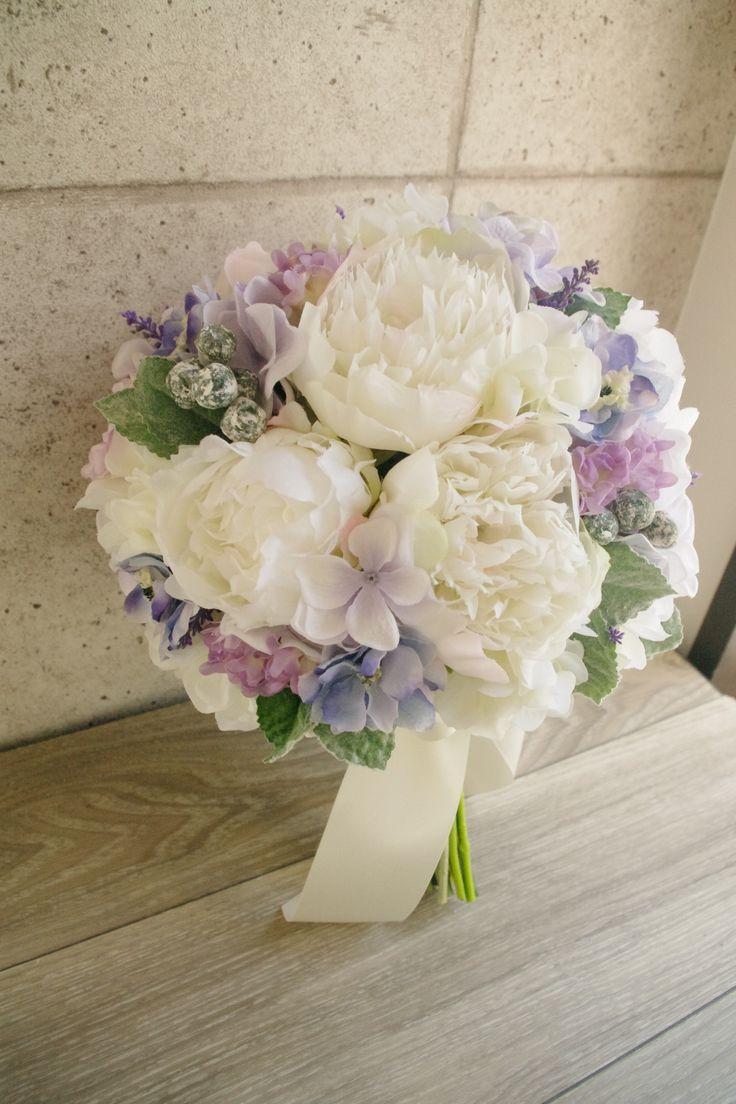 Purple & white bouquet                                                                                                                                                     More