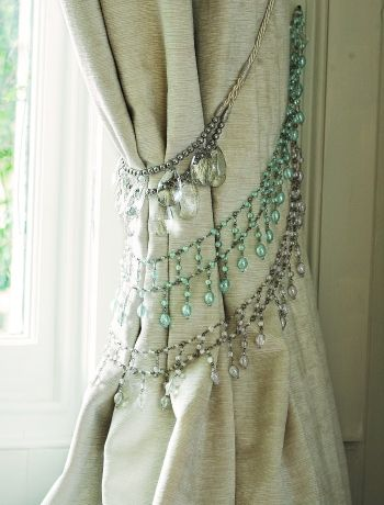 Vintage necklaces as curtain ties.