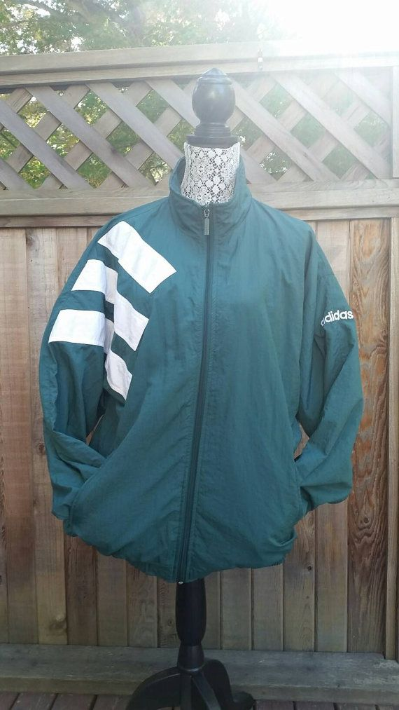 Check out this item in my Etsy shop https://www.etsy.com/ca/listing/468487366/90s-adidas-windbreaker-large-stripes