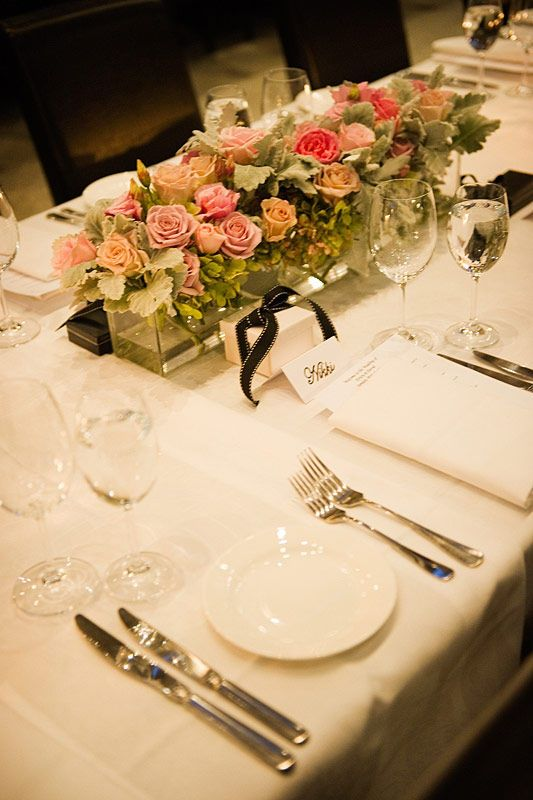 Tank vases brimming with beautiful David Austin roses, green hydrangea and silver suede ran down the centre of these banquet tables at Stones of the Yarra Valley. Flowers and styling by Victoria Whitelaw Beautiful Flowers.