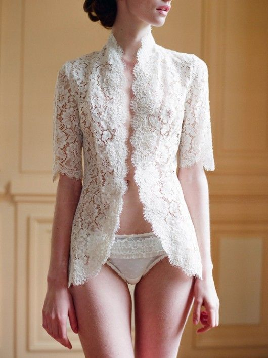 Lace. I love lace. And this looks very much like a kebaya. -KEREN