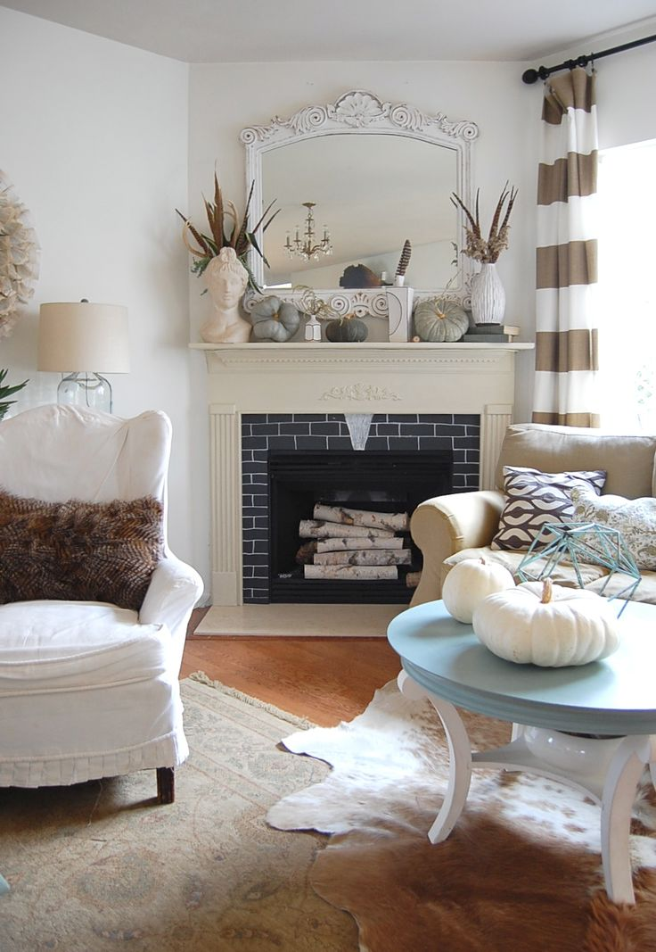 Love the palette, the slipcovered chair, the birch logs,