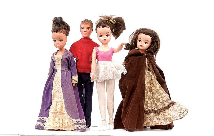 The Sindy on the far right had a velvet cape with a gold tassel and a brown 1970s lace full length dress. I loved the cape. Very alternative Red Riding Hood.