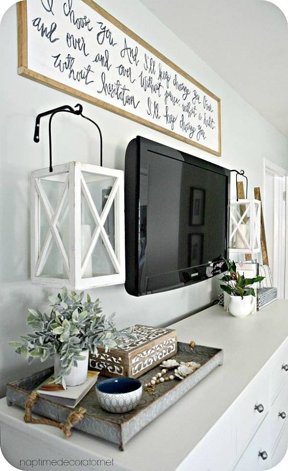 Find and save ideas about Decorate around tv on Pinterest. | See more ideas about Tv wall decor, Decorating around tv and Pictures around tv.