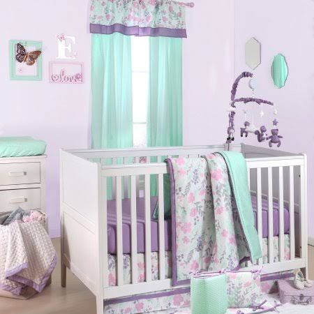 Create a soft and stylish spot for your little one with the peanut shell floral crib bedding set in purple and mint the cotton sateen set includes a quilt
