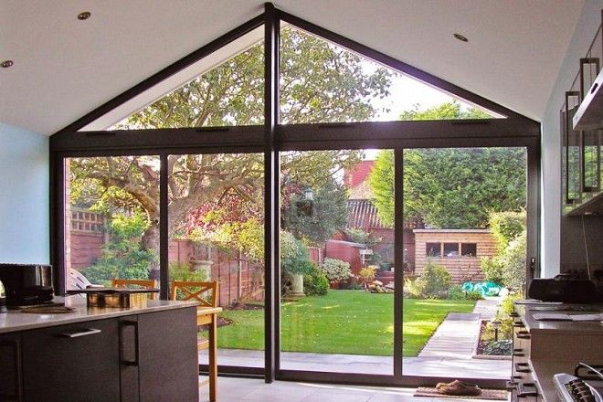 Aluminium four panel sliding doors with glazing above. Internal view of glazed gable.