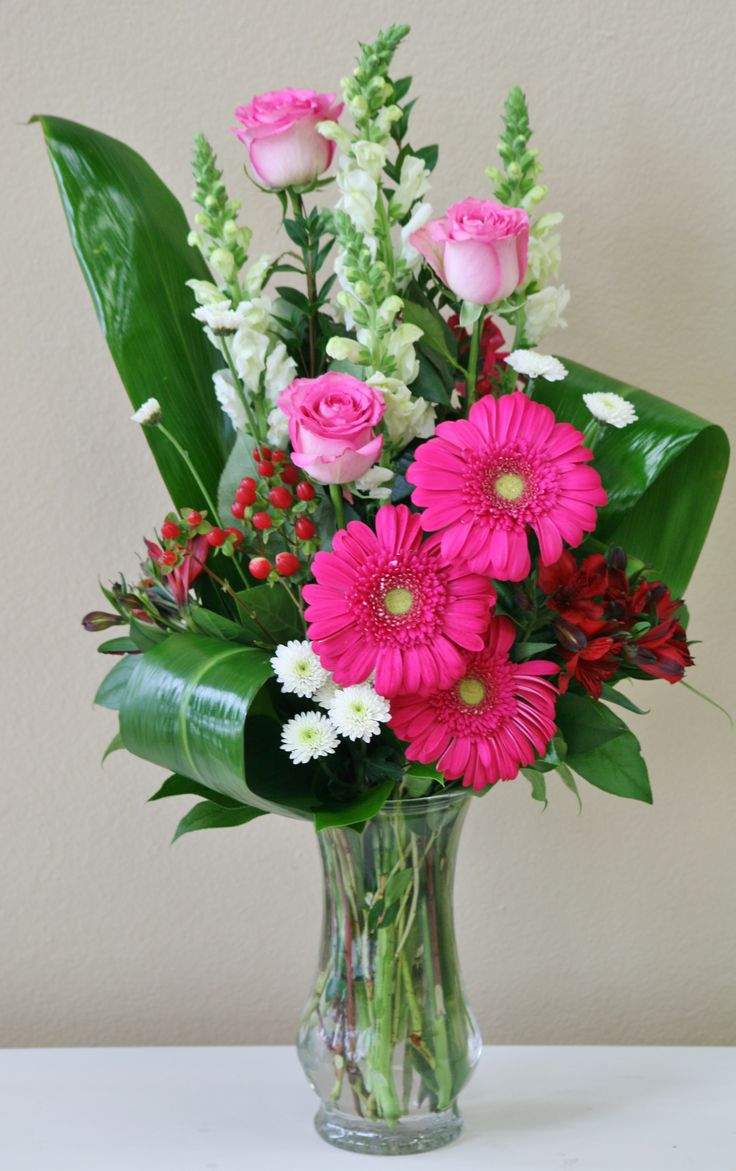 Pink roses and pink gerberas in this vase of pink and white flowers by Willow Branch Florist of Riverside