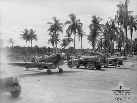 A Spitfire of 79 Sqn RAAF, taxiing along a dispersal road at Momote airfield, Los Negros Island, Admiralty Islands. Apr-1944