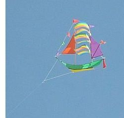 Different kinds of kites seen at festivals - a novelty ship kite, complete with flags and sails