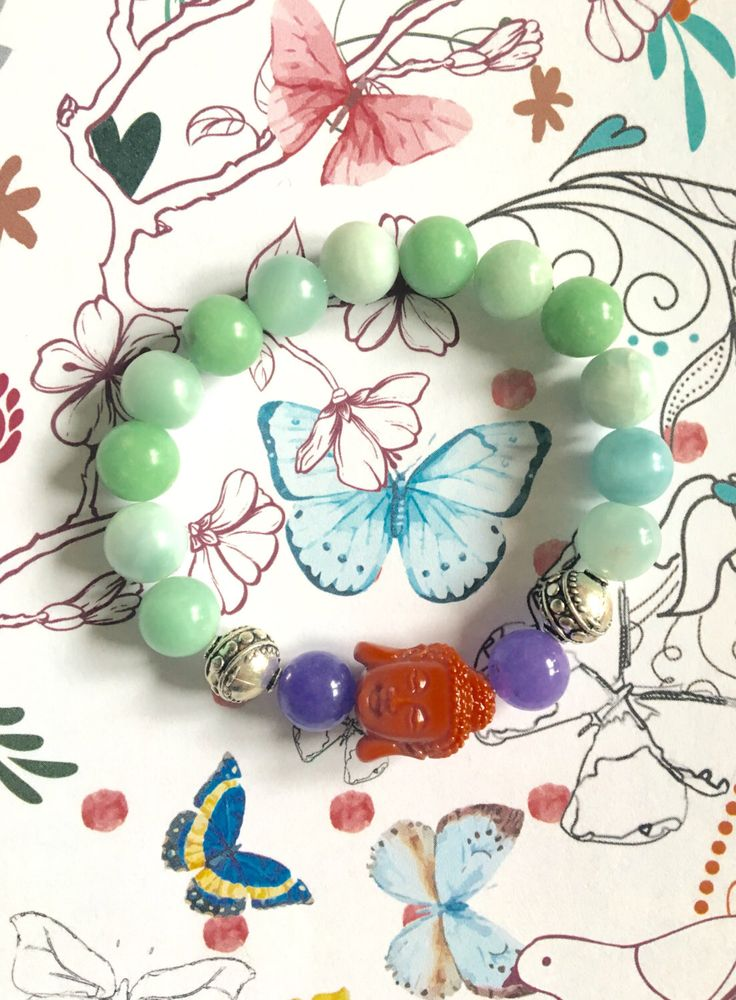 A personal favorite from my Etsy shop https://www.etsy.com/listing/469076719/amazonite-with-buddha-charm-bracelet
