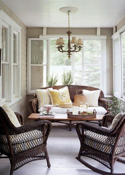 Screened Porch....old wood floor painted white, antique chandelier, wicker and pale yellow cushions....so comfortable!