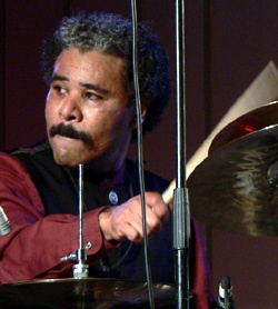 Anthony Brown is a jazz percussionist, drummer, composer, bandleader, and ethnomusicologist. He is the son of a Choctaw and African American father and a Japanese mother. He specializes in the juxtaposition of American and Asian instruments and styles in his compositions. Brown leads the Asian American Orchestra, whose interpretation of Duke Ellington's Far East Suite was nominated for a 2000 Grammy Award.  Brown obtained degrees in music and psychology at the University of Oregon.
