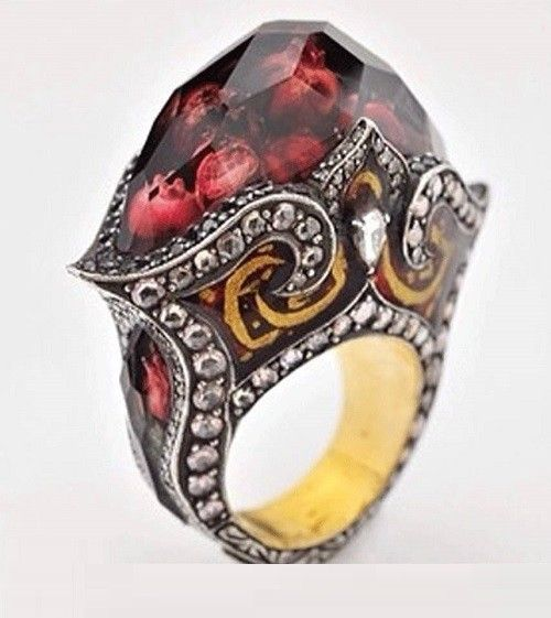 Sevan Bicakci, pomegranate ring. Looks like seeds frozen in a jewel of fruit, meant to be worn in a fairy tale.
