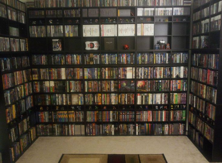 Floor to ceiling DVD shelving Whoa!!! We have over 1,000 this would be perfect.
