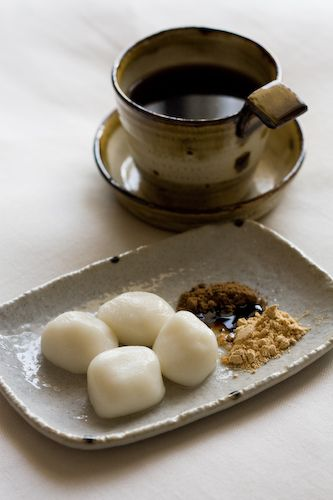 Coffee and Japanese rice-cake sweets with brown sugar and soybean flour