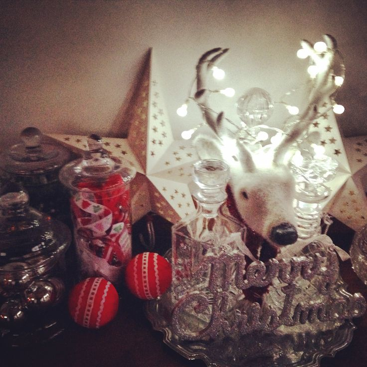 Combine fairy lights with fav Xmas decorations to create a festive hallway table