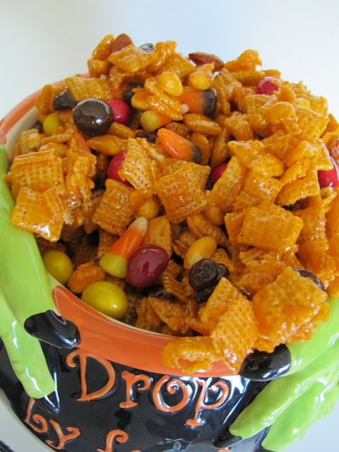 Halloween Hash Recipe ~ yummy, gooey, orangey Chex Mix treat that is filled with  candy corn, Peanut M&Ms, peanuts, almonds, dried cherries and raisins