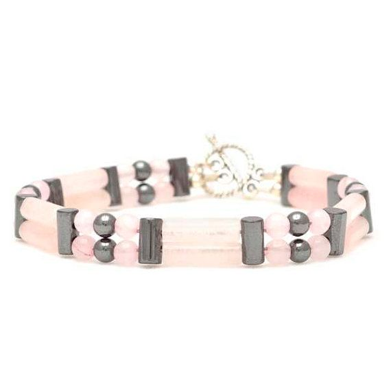 This unique, custom-designed Double Bracelet is made of Rose Quartz, Hematite and Sterling Silver Beads, on nylon coated flexible wire. A Tibetan Silver Toggle Clasp finishes this Bracelet. Comes in a gift box.    Rose Quartz Properties:  • Master Healer for the heart and emotions  • The stone of unconditional love  • Promotes fertility  • Removes negative energy  • Helps with mid-life crisis  • Soothes internalized pain  • Attracts love  • Encourages self-forgiveness and acceptance  •…