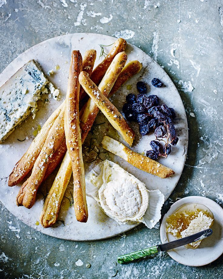 Herby homemade breadsticks, scattered generously with sea salt, make an impressive addition to any cheese board or crudités platter.
