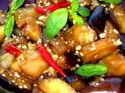 This is a great eggplant recipe - you can use a few generous sprinkles of crushed red pepper if you don't have chillis.