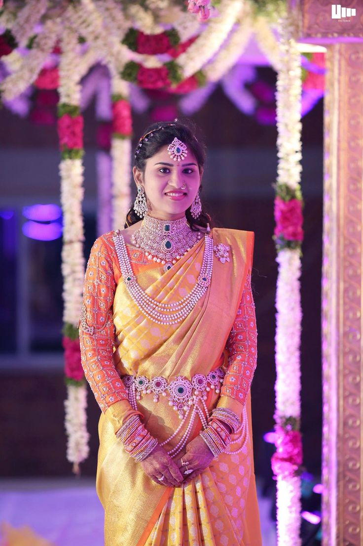 Sparkling South Indian Bride in Yellow Silk Saree with Orange Blouse and Diamond Jewelry