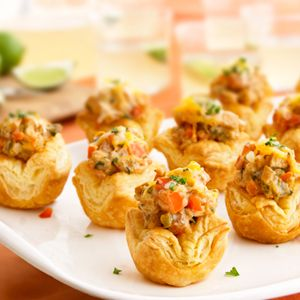 king ranch chicken shells --Mini puff pastry tarts are filled with a spicy chicken mixture and topped with melted cheese to make this outrageously good appetizer.