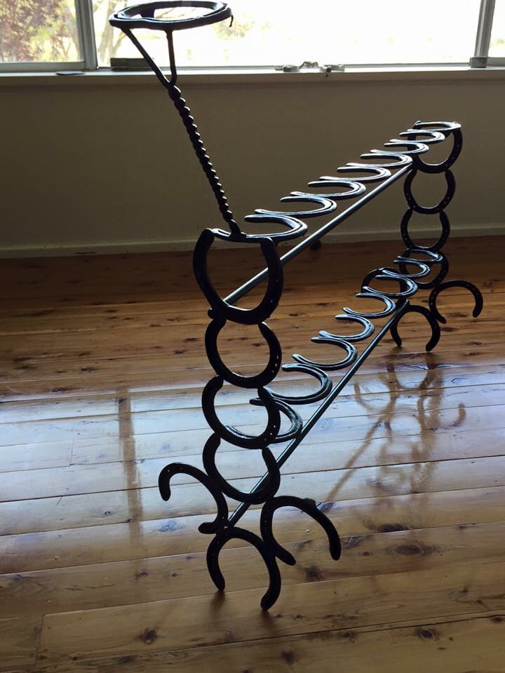 Horse shoe boot rack with hat stand