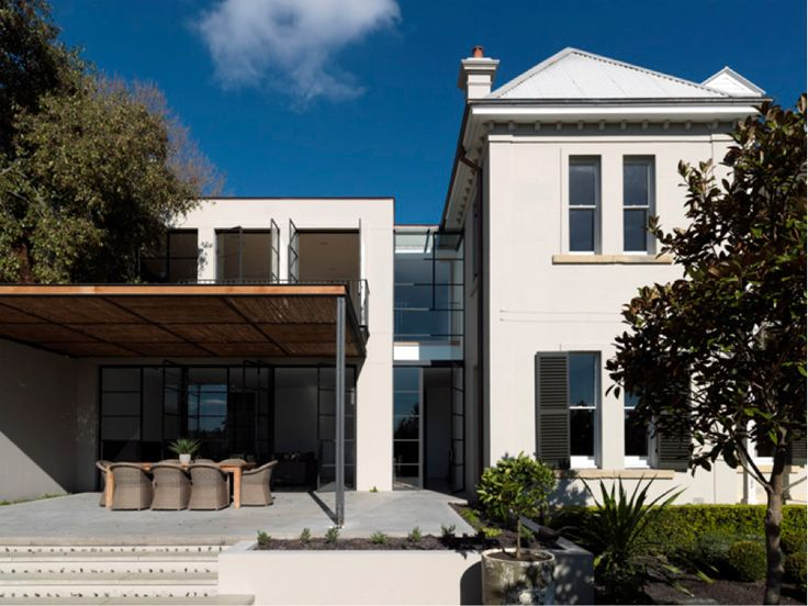 This is a successful example of a new design for an old dwelling as the new respects the old with a clear de-lineation between the two. The materials and finishes that the architect has selected gives the building a fairly understated minimalist feel, despite its size.  The modern wing contains an expansive new kitchen and family room on the ground floor and a study and staff quarters above