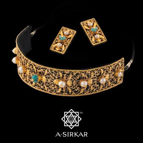 Zardozi: This collar, adapted from a filigreed Victorian cross, is also embroidered, but in real gold, as zardozi once used to be, and serves as a tribute to one of the greatest craft traditions of India and one that cries out for its talented but impoverished artists to be recognised and cared for. The fine salma arabesque is studded with pearls, and a lone raw turquoise is set in the centre - An extraordinary piece of craftsmanship and an absolute showstopper.