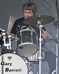 Gary Barratt's drumming, recorded at both the GDrumsB Studio and at The Tragicically Hip's Bathouse Recording Studio and engineered by Nyles Spencer, was mixed and produced by Rob Begg for Clive Barratt's 2014 Wall of Storms album. Gary Barratt can be found on Twitter at @GDrumsB