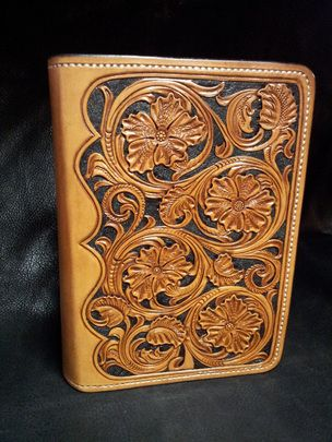 Leather tooled Bible cover.