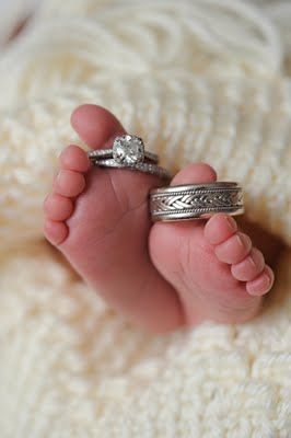 This could actually be a really cute picture for all three kids. One of each of their feet in the picture. Hero can have my engagement ring (diamonds are a girl's best friend, right?), and the boys can have our wedding rings, since they're identical other than size.