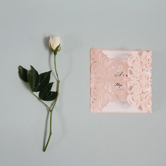 Laser Cut Wedding Invitation: The True Romance Invitation is an envelope style design that features two opening sides of delicate floral cut swirls. A very romantic and intricate style that is available in a range of colours. Main invite is double sided with information.