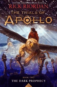""""""" The Dark Prophecy (Trials of Apollo Series; Book Two) by Rick Riordan Leaving the safety of the demigod training ground, a disgraced Apollo embarks on a quest across North America to find a dangerous ancient-world Oracle while navigating the challenges of the evil Triumvirate. """""""