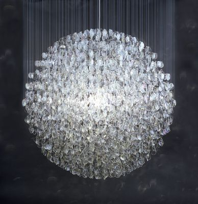 """Stuart Haygarth, """"Optical"""", 2007 Stuart Haygarth states his work is about granting """"banal and overlooked objects a new significance"""". He collects everything from plastic cups to old eyeglass lenses and taillights and transforms them into useful and aesthetically stunning objects, (most often, lighting). Seeing beyond the limits of the narrow scope of an object's original function characterizes his perspective on creating"""