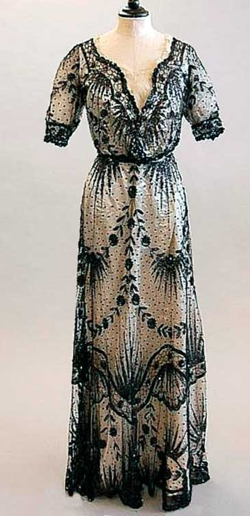 Sequined ball gown, ca. 1900. Black spangled tulle over ivory silk ground. Kerry Taylor Auctions