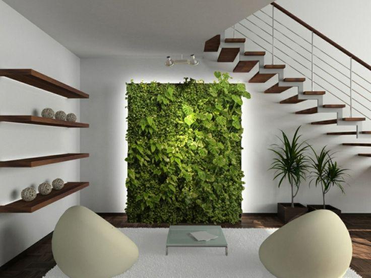 sala moderna con jardín vertical y escalera colgante