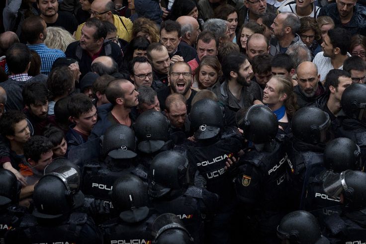 Spanish National Police block people trying to reach a voting site in Barcelona on October 1, 2017.