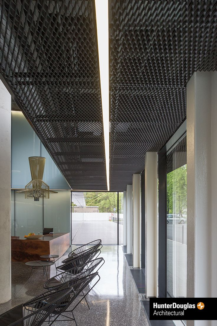 A Black Stretch Metal Ceiling By Hunter Douglas Architectural