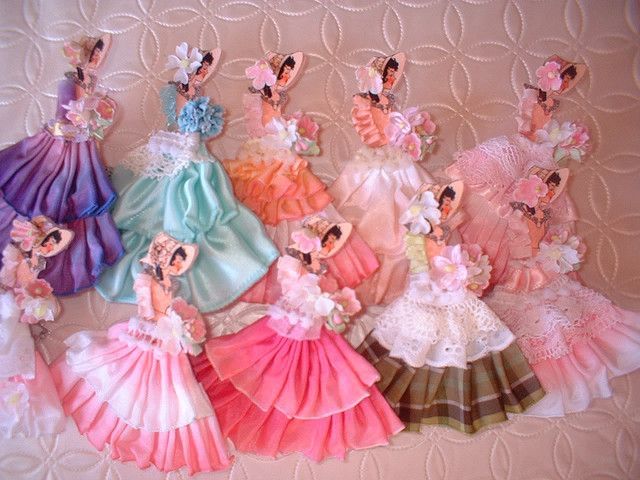 these are the ribbon dolls ...I have a pattern I shunk down and made the girlies in My girls fav colors...