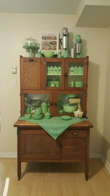 My Hoosier cabinet with some of my favorite jadeite pieces