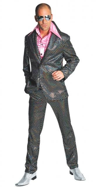 Abito giacca e pantaloni nero pailette moda anni 80, del costume luccicante e iridescente di quegli anni spensierati. Giacca attillata corta pantaloni stretti a tubo, linee essenziali giocate di riflessi in movimento delle paillettes colore cristallo a diamante. Pantaloni con tasche cerniera, elastico dietro