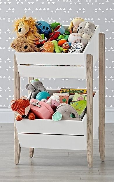 ur Wrightwood Toy Storage Crates will feel right at home in any room of your house. The toy box's unique design features two large compartments that can hold everything from toys to sports gear. Plus, the stunning, two-tone finish in stained grey and white allows this toy box to coordinate with your other furniture and decor while still standing out on its own.