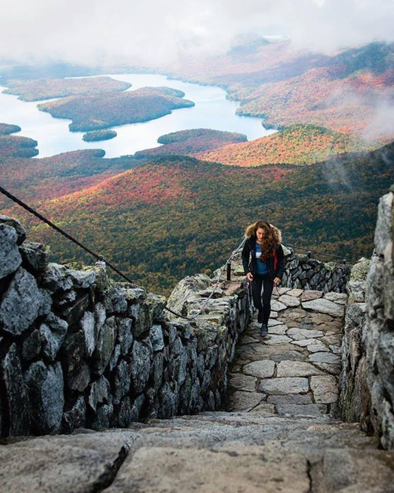 Moody clouds and sunlit glimpses of Lake Placid   Whiteface Mountain New York   Chelsea Yamase Say Yes To Adventure